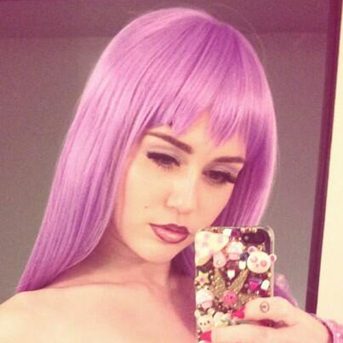 Miley Cyrus as Lil' Kim For Halloween