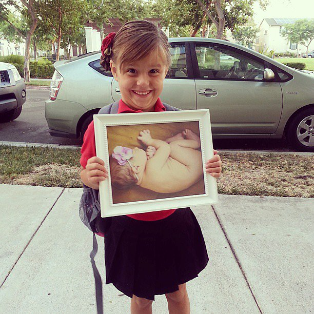 When you're proud of yourself for doing the picture-in-a-picture idea only to realize later that she's holding her sister's baby photo instead of hers.  Source: Instagram user mmkenison