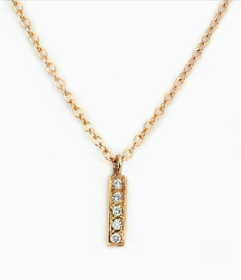 For the very special ladies in your life, this Satomi Kawakita Diamond Bar Necklace ($660) might just do the trick.
