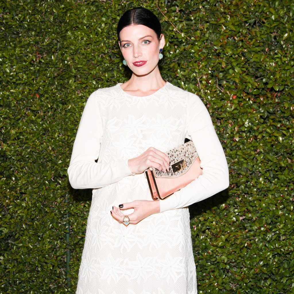 Jessica Paré's center-parted style and deep purple lips were a hit at the Chloé fashion show and dinner.