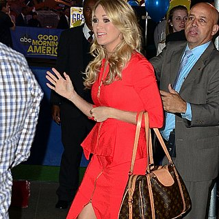 Carrie Underwood Wears Red Dress and Louis Vuitton Bag