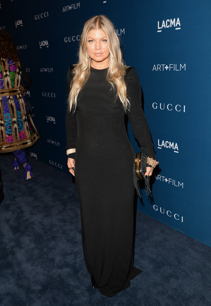 Fergie opted for one of the night's more conservative looks with a black long-sleeved dress with gold embroidery detailing at the shoulders. She added extra drama with gold cuffs and a fringed leather Alexander McQueen box clutch.