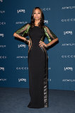 Zoe Saldana showed off her toned silhouette in a daring custom Gucci gown with green and black velvet trim — not to mention sheer mesh paneling down the entire length of the dress.