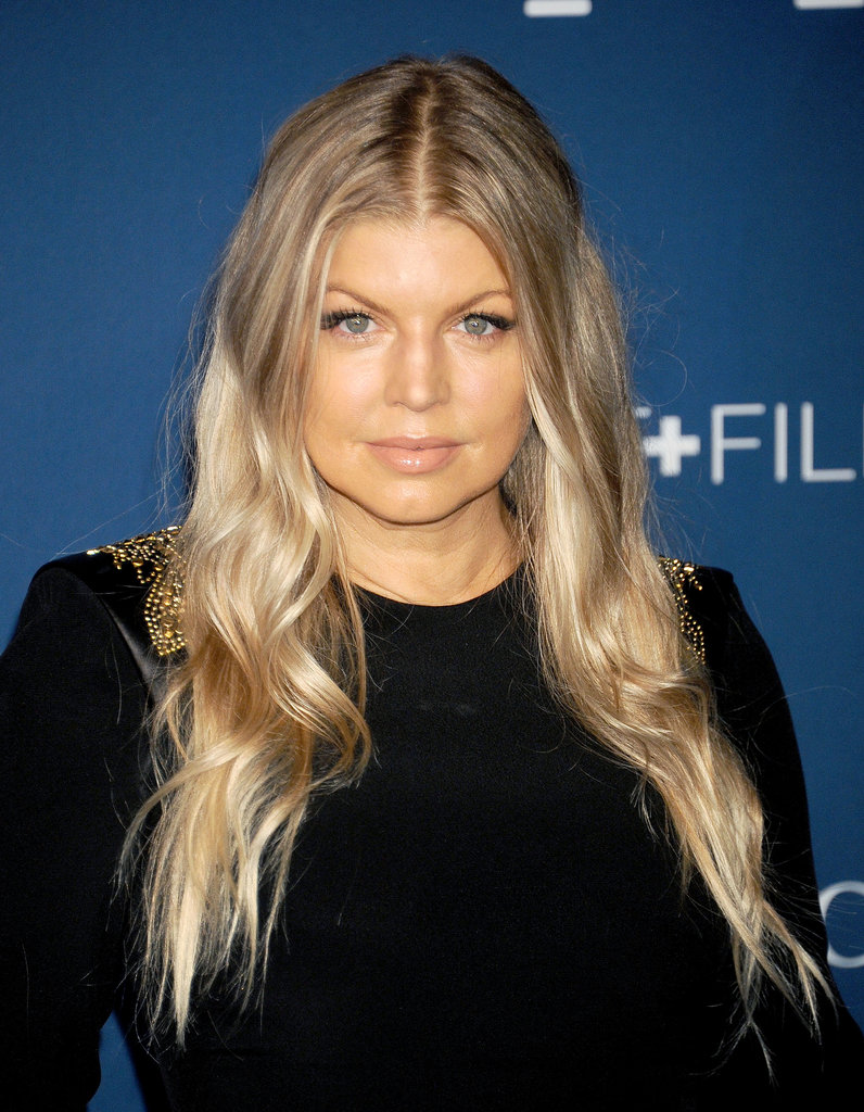 Middle part, blond waves, and nude makeup made up Fergie's look for the night.