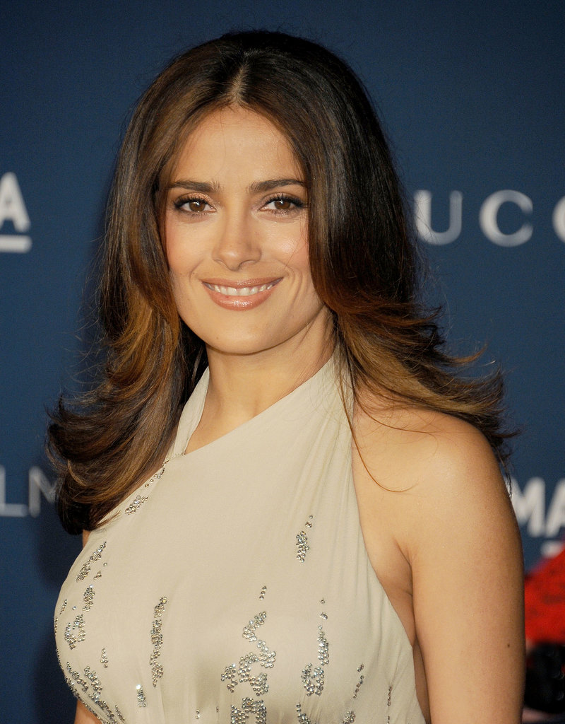 Salma Hayek's caramel highlights played perfectly off her golden complexion, and we love how her Farrah Fawcett flips left room to show off her halter neckline.