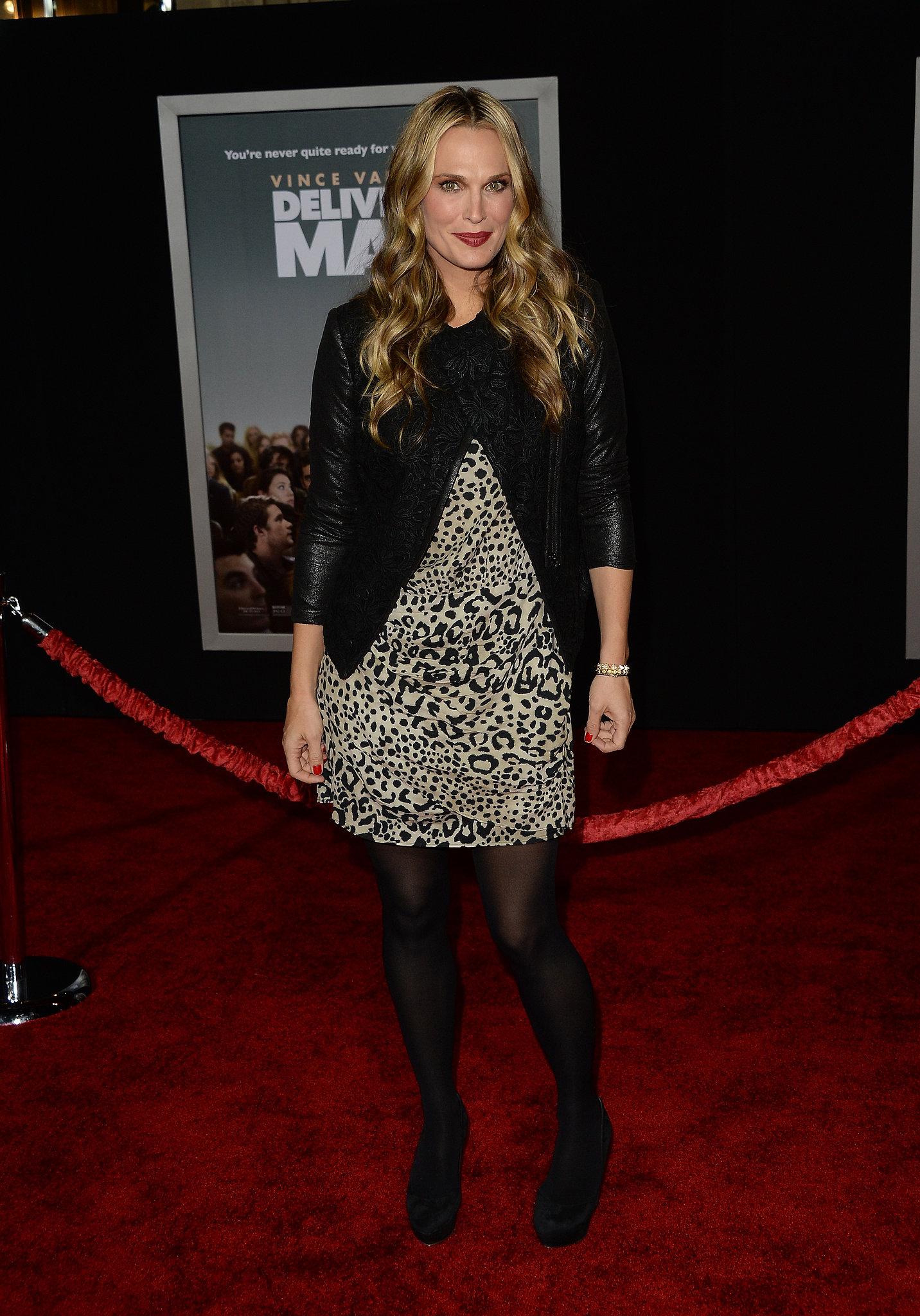 Molly Sims walked the red carpet for Delivery Man in a leopard-print dress and black accents.