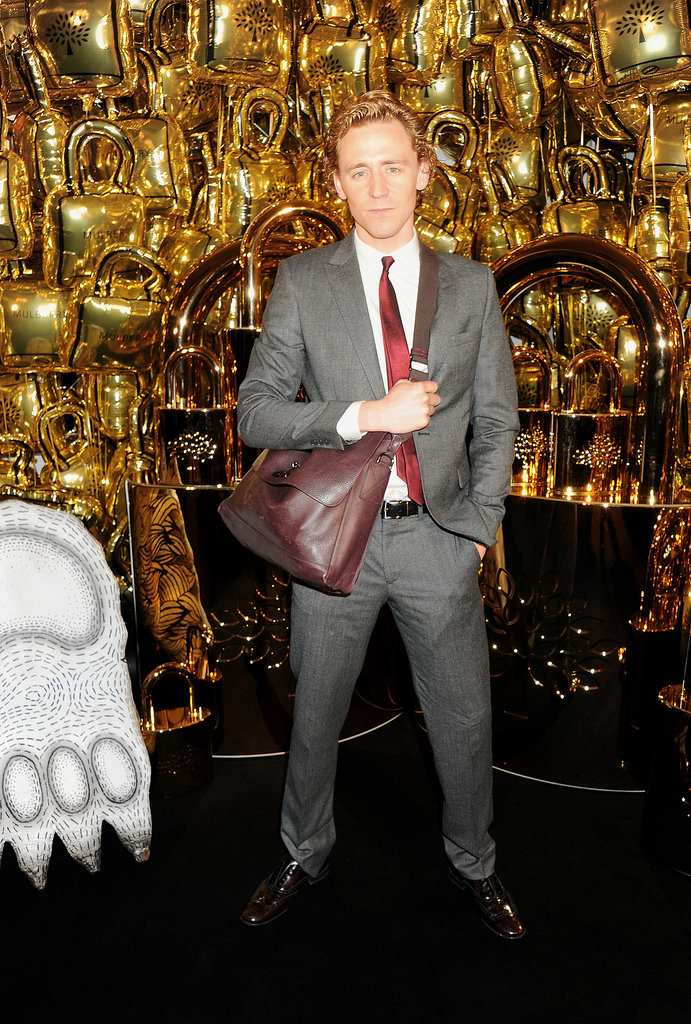 Tom Hiddleston modeled a man bag.