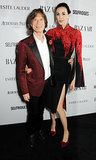 Mick Jagger and L'Wren Scott posed for photos at the Harper's Bazaar Women of the Year Awards in London on Tuesday.