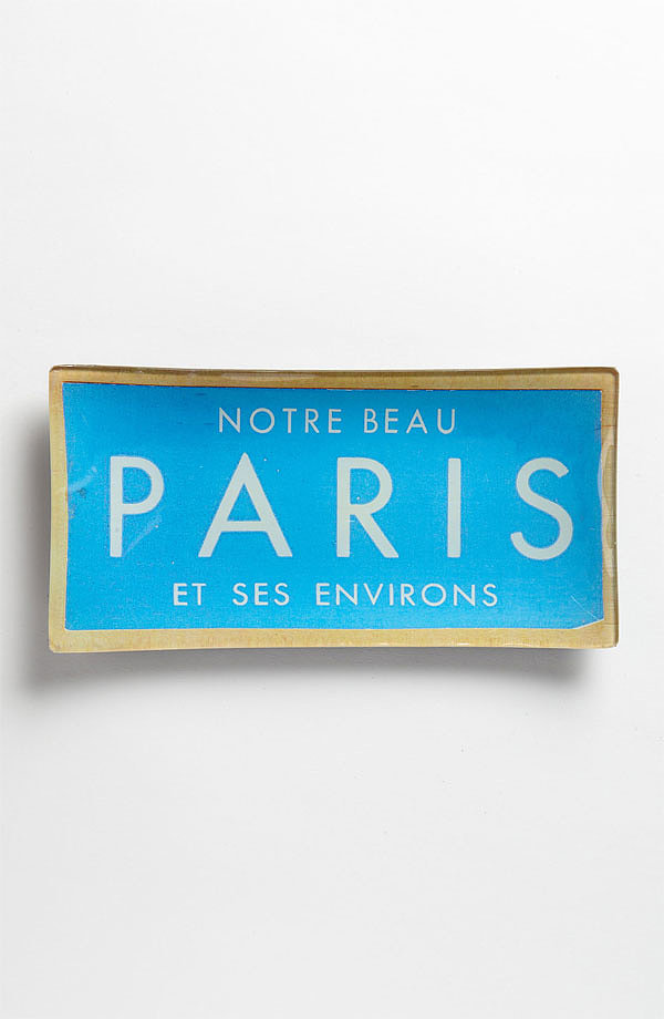 This découpaged trinket tray ($58) pays homage to a Parisian vintage ticket.
