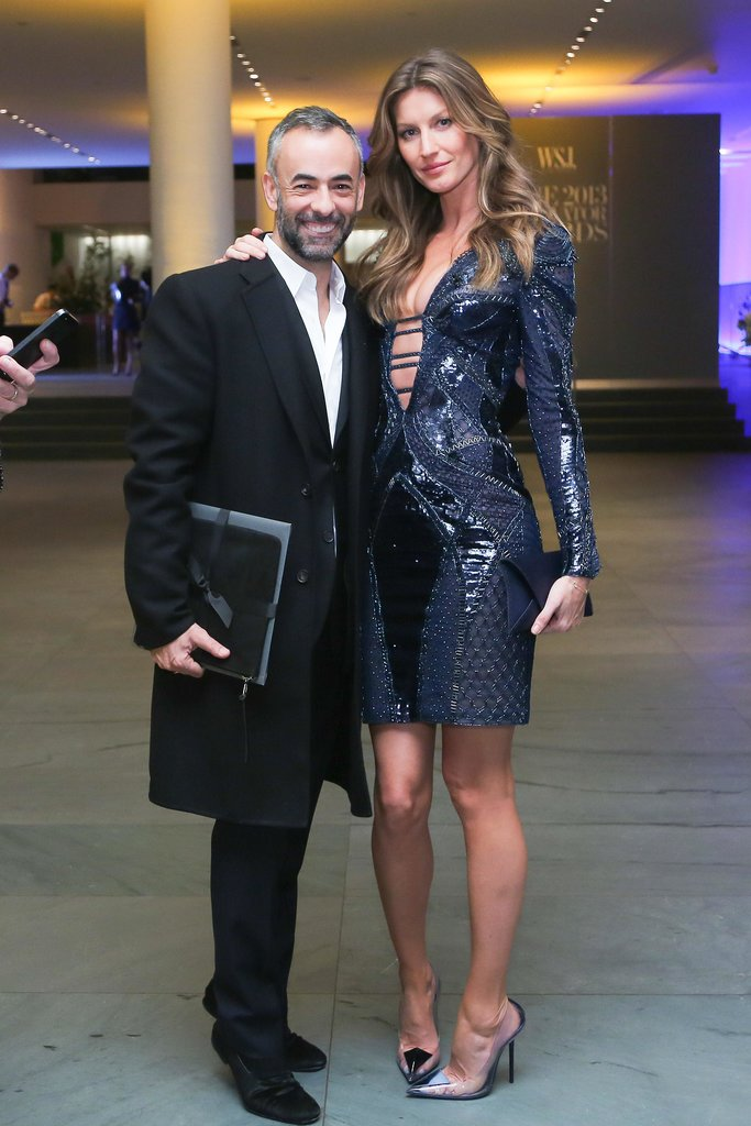 Gisele Bündchen joined Francisco Costa for the WSJ. bash in the sexiest of Atelier Versace cocktail dresses and Cartier jewels.