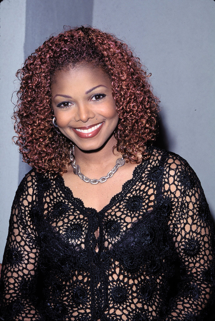 Loads of lip liner, penciled-in brows, and red curls were Janet Jackson's look of the '90s.