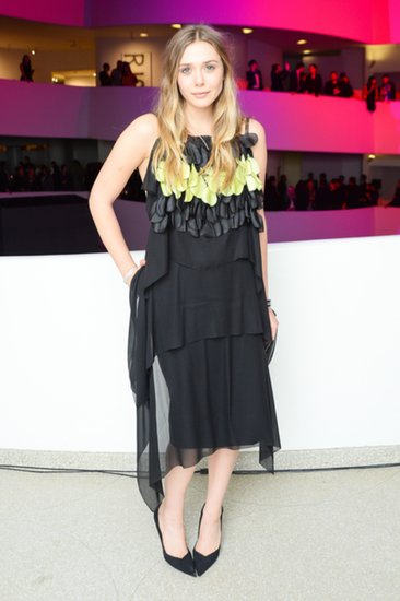 Elizabeth Olsen was decked out in Dior Haute Couture at the preparty for the Guggenheim International Gala. She accessorized her cocktail dress with a pair of heels and a diamond bracelet, also by the brand.