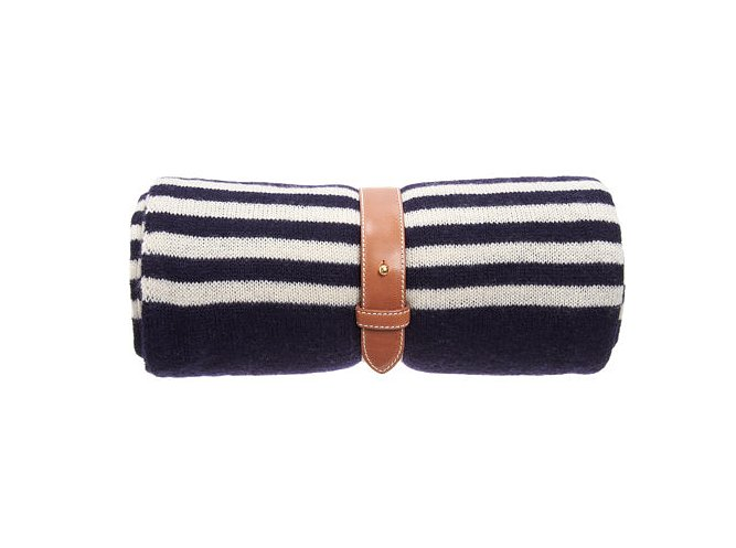 Who wouldn't want to get comfy with a chic cashmere Armand Diradourian travel blanket ($495) that folds up in your carry-on but that's equally stylish for displaying at home.
