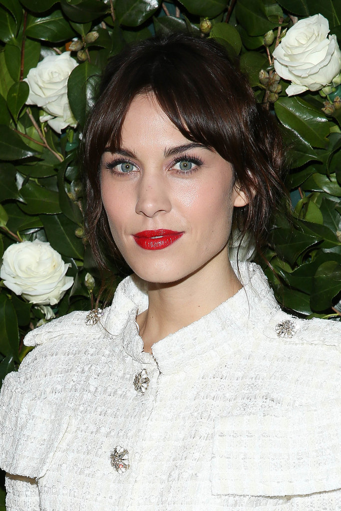 Alexa Chung was outfitted in Winter white for the Museum of Modern Art 2013 Film Benefit, and she proved the best way to complement a blank canvas is with a saturated red lip. Parted bangs are optional.