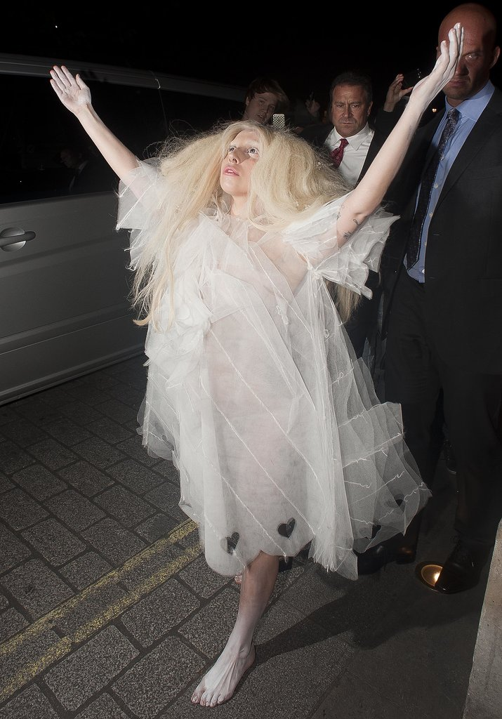 If there is a theatrical way to arrive to a hotel, Lady Gaga will find it. Here she is in a diaphanous layered white dress at a hotel in London.