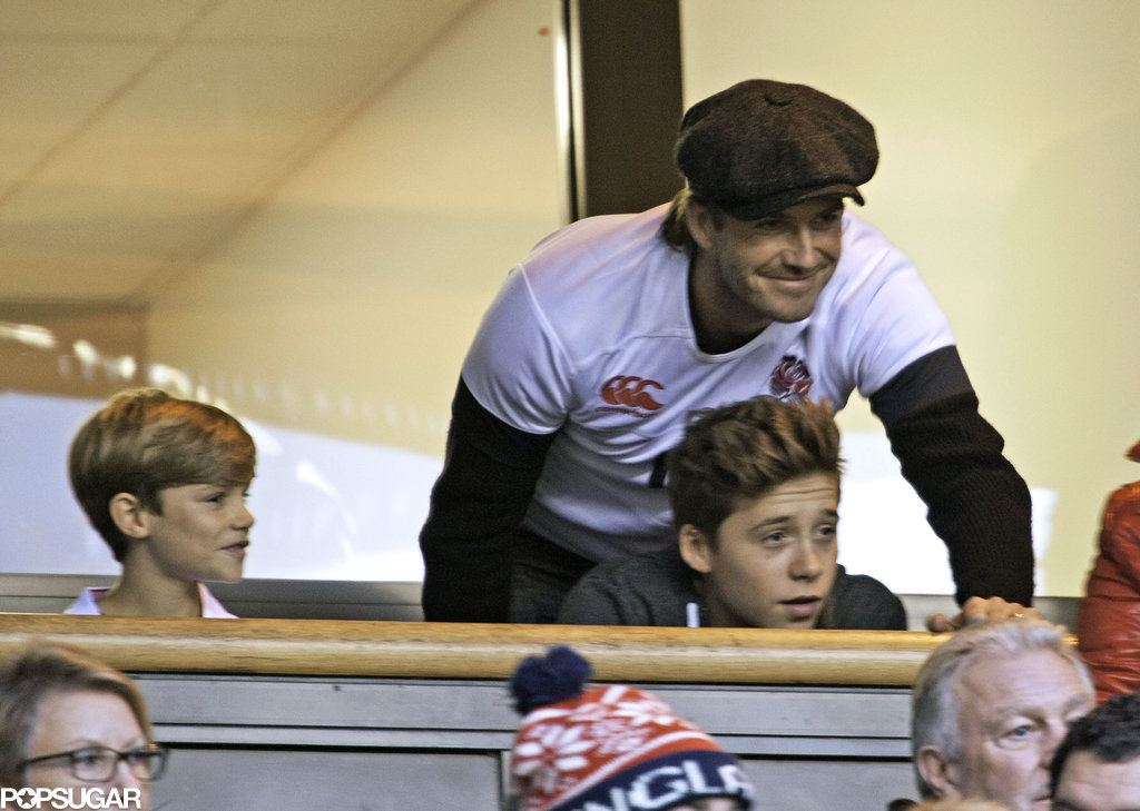 David Beckham and his sons Romeo and Brooklyn watched a rugby match in London.
