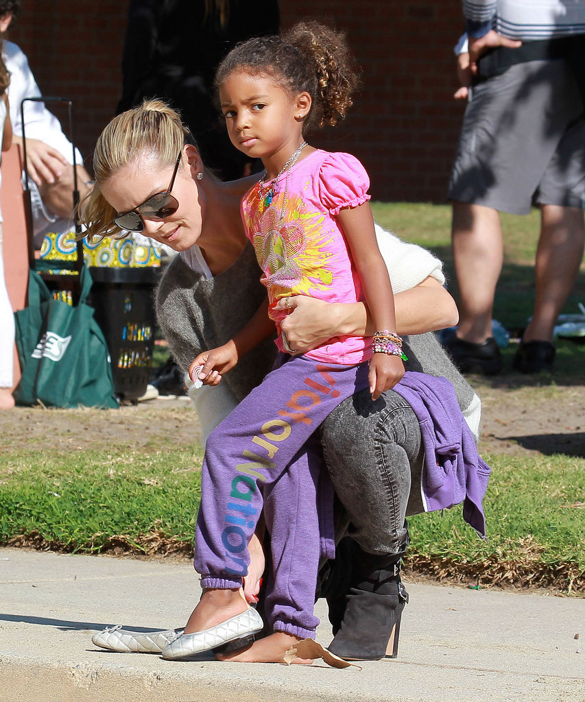Heidi Klum helped Lou with her shoes at an LA park on Saturday.