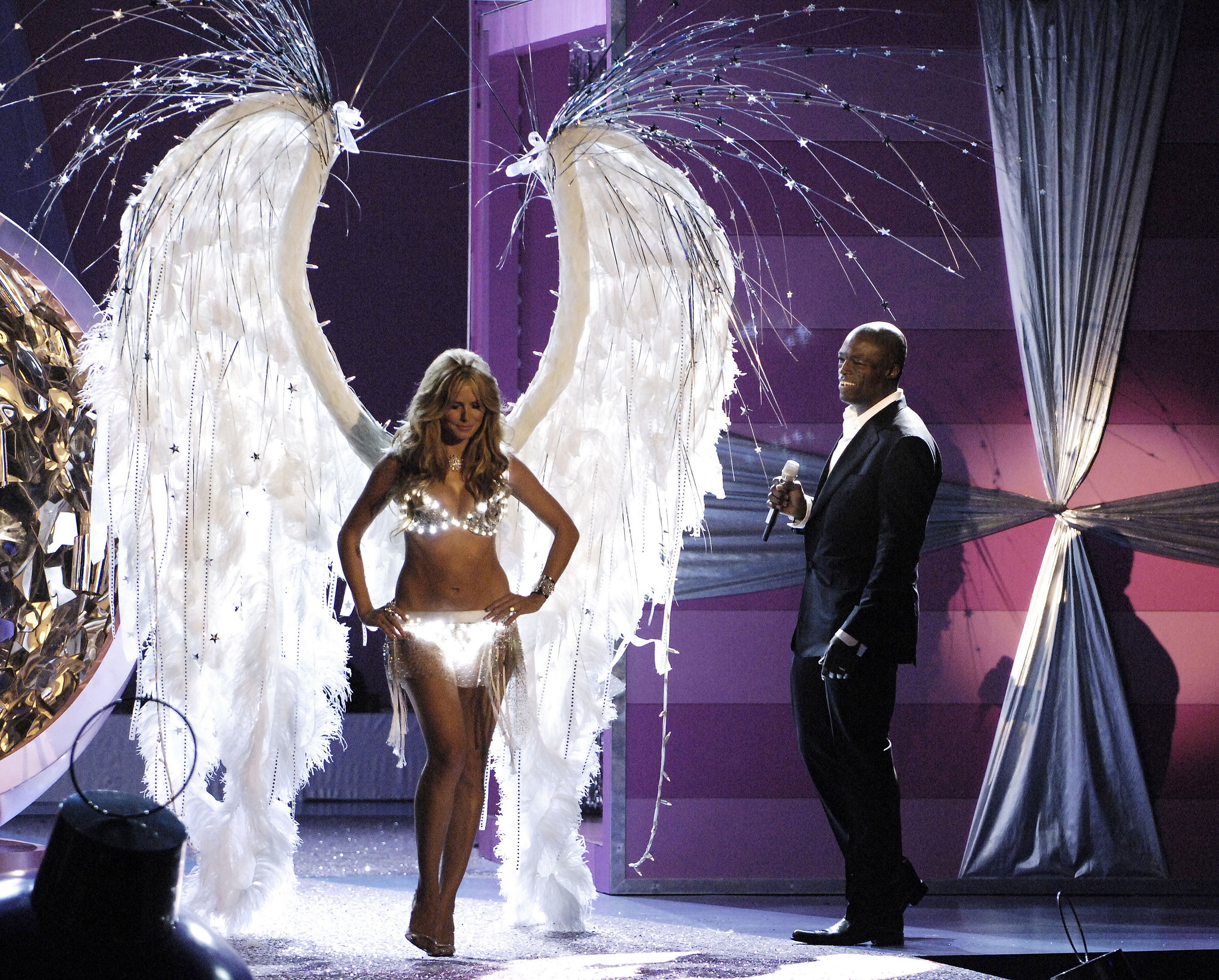 Heidi Klum flashed a smile at husband Seal while wearing glowing angel wings in 2005.