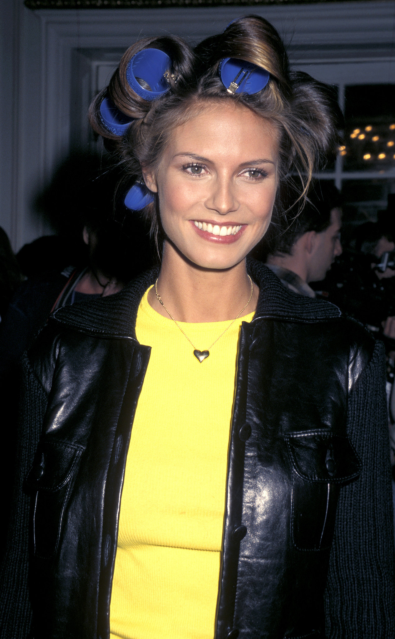 Heidi Klum was done up in rollers backstage at the 1997 show.