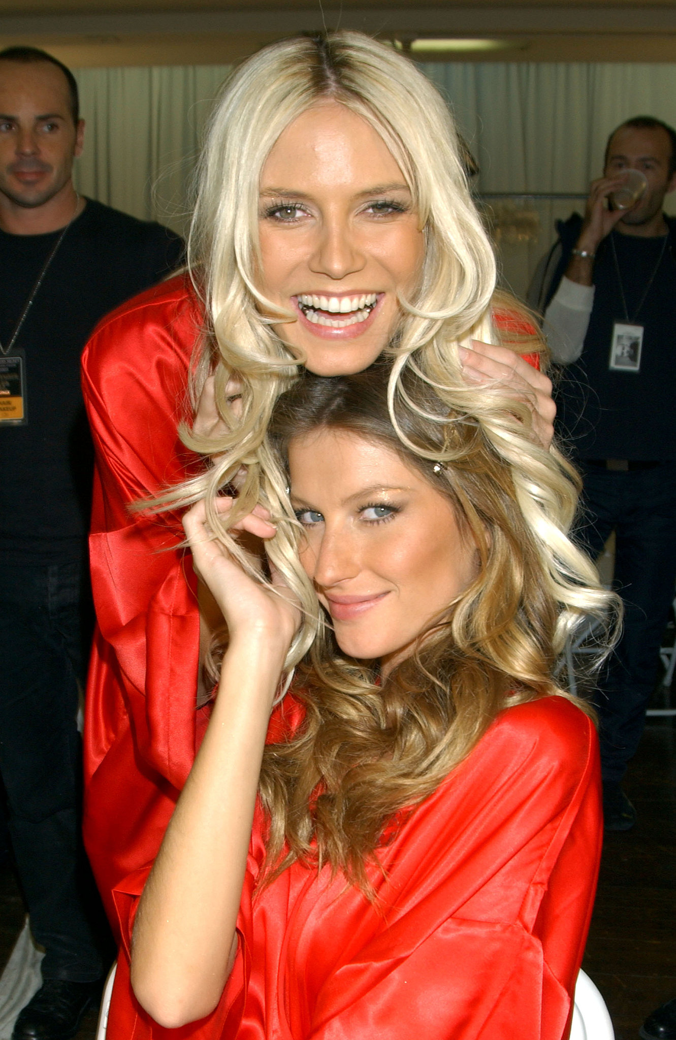 Heidi and Gisele got silly backstage in 2003.