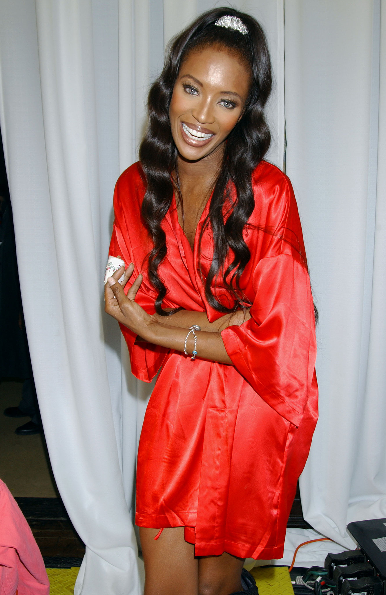 Naomi Campbell smiled big while backstage in 2003.