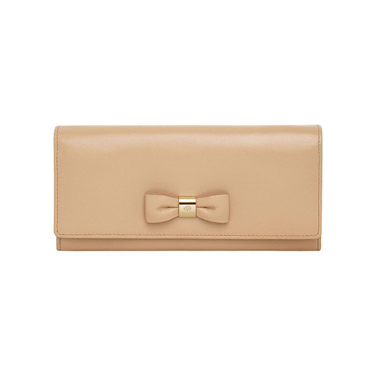 Mulberry Bow Continental Wallet in Classic Napa ($500)While Kate Middleton's favorite handbag, Mulberry's Polly Push Lock purse, is no longer available by the brand, we imagine that she would approve of this wallet from the leather goods company.