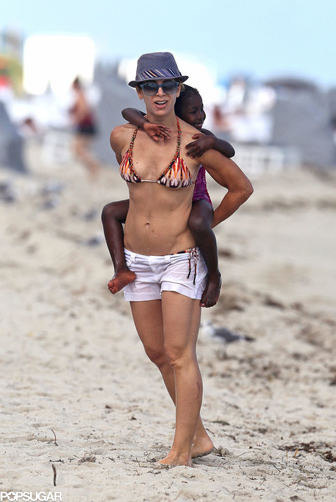 Jillian Michaels carried her daughter, Lukensia, on the beach during her family's vacation in Miami on Monday.
