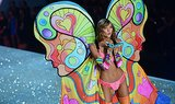Karlie Kloss blew a big kiss when she donned a bright butterfly ensemble.