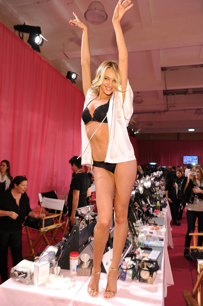 Candice Swanepoel stood on a table and showed off her toned body.