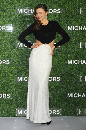 Miranda Kerr traveled to Tokyo with Michael Kors to celebrate her December 2013 cover of Elle Japan. She chose a black-and-white crystal embroidered gown from the designer's Resort 2014 collection for the occasion.