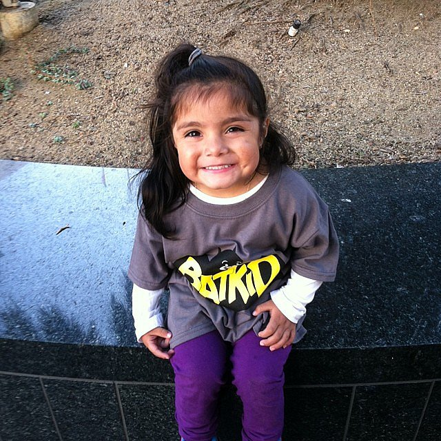 This little supporter offers Batkid an ear-to-ear grin.  Source: Instagram user lilm415