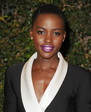 12 Years a Slave star Lupita Nyong'o stunned in a black-and-white dress, which she wore with a metallic plum lip color to bring attention to her stunning features.