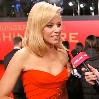 Elizabeth Banks Wearing McQueen in Catching Fire Interview