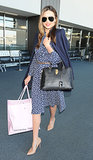 Miranda Kerr knows how to make a ladylike appearance in her printed blue dress, nude shoes, and black bag.