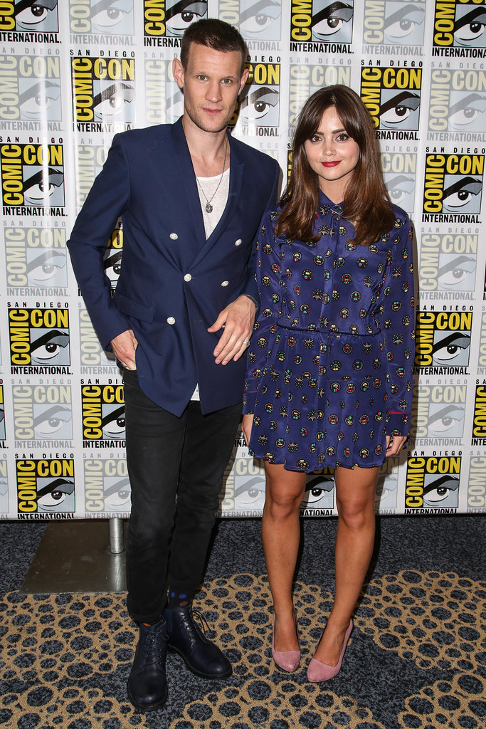 Posing with Matt Smith at Comic-Con, Jenna wore a blue silk dress buttoned up to the neck and pretty pink shoes.