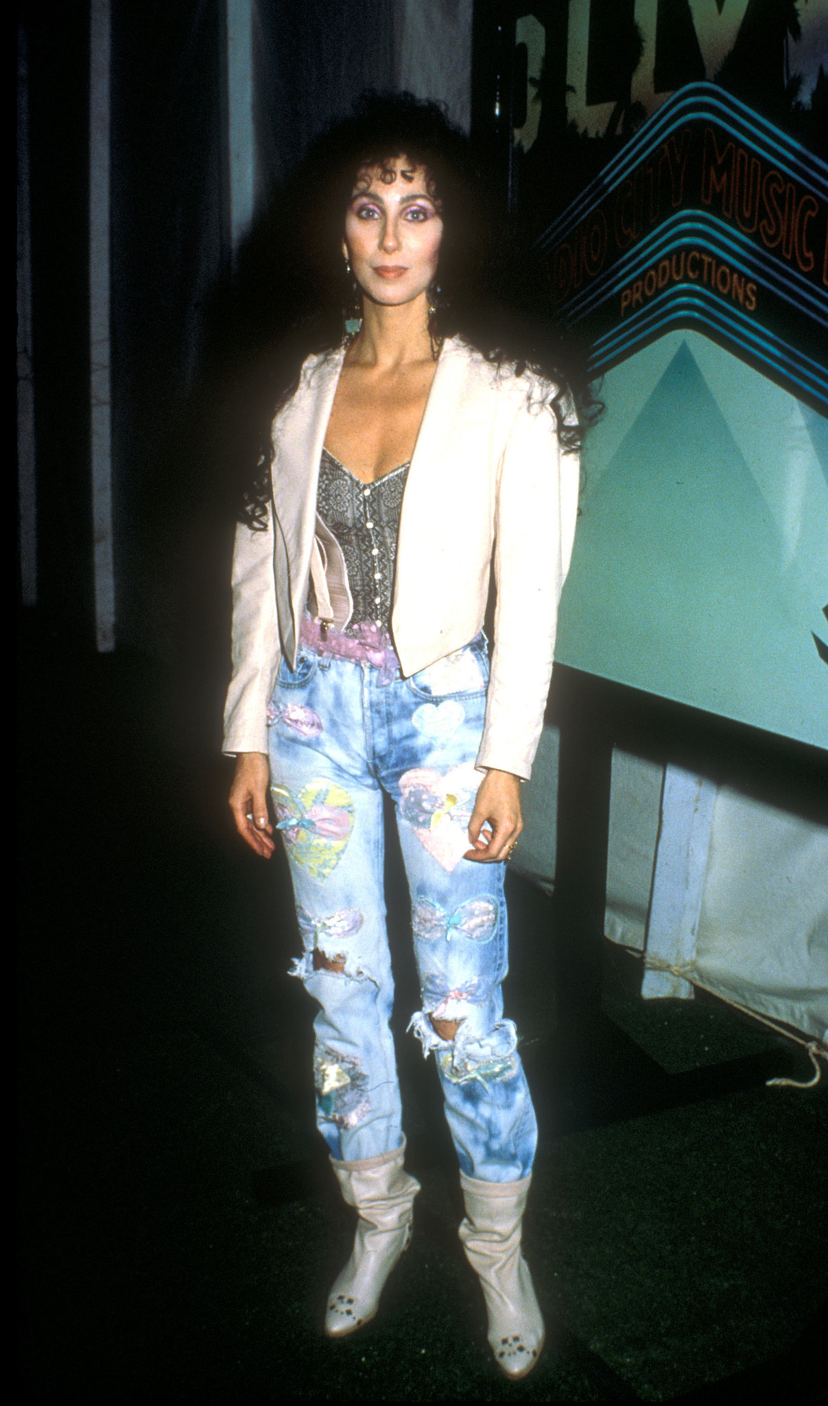 Cher was snapped backstage in ripped jeans and a white leather jacket at the 1988 show
