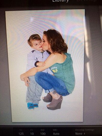 Alyssa Milano had a little visitor (Milo!) on the set of her photo shoot. Source: Twitter user Alyssa_Milano