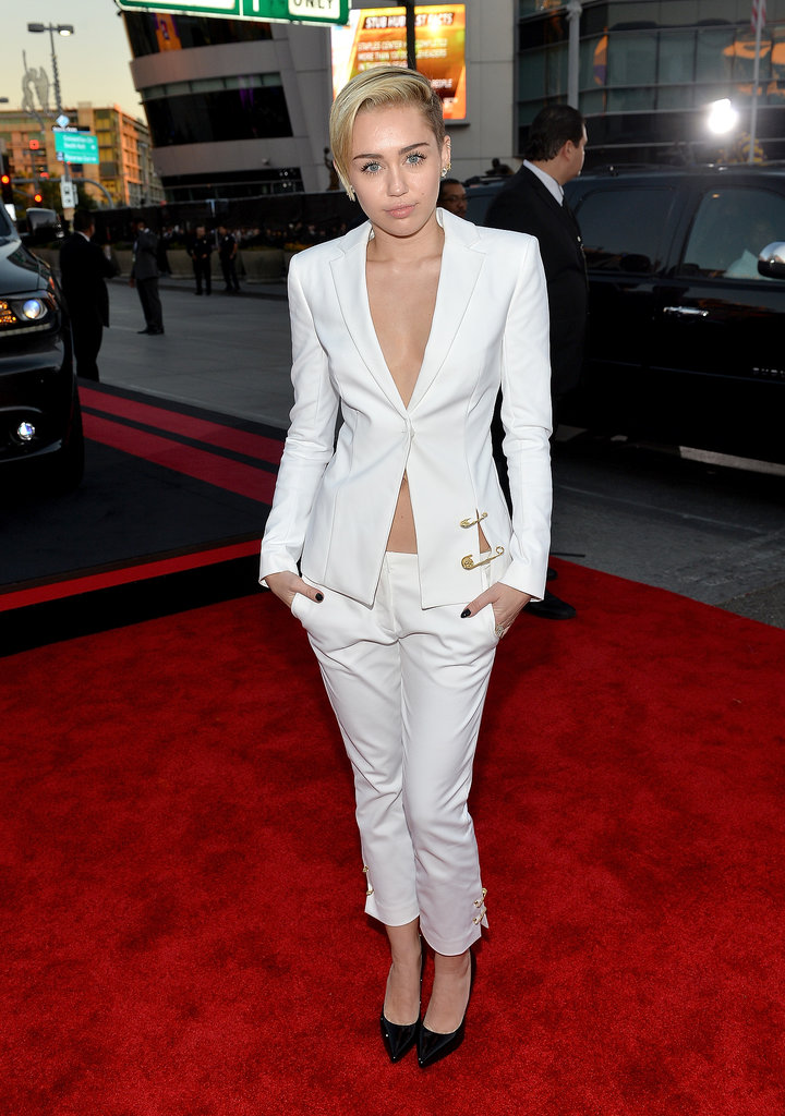 Miley Cyrus bared her cleavage in a white ensemble.