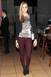 Cara Delevingne makes it easy to get festive with a pair of red skinnies and a metallic top.