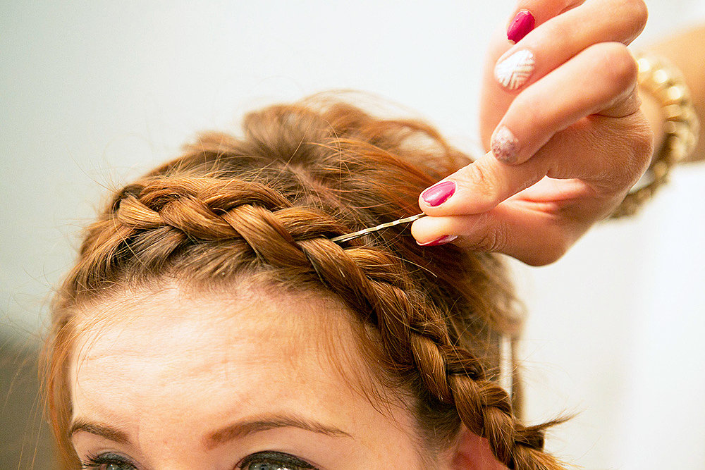 Huffnagle likes to use the end of a bobby pin to tuck stray hairs into your braid for a clean look. Source: Caroline Voagen Nelson