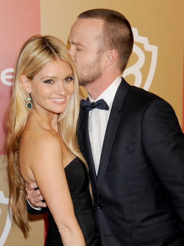 Aaron Paul gave Lauren Parsekian a kiss at the InStyle Golden Globes bash back in January.