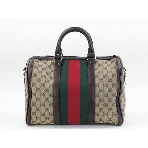 This time of year, there's no better color combination than red and green, and thus, no better designer accessory than the Gucci Vintage Web Boston Bag ($1,180). — KS