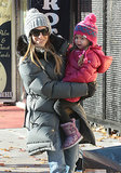 Sarah Jessica Parker carried her daughter Loretta in NYC on Monday.