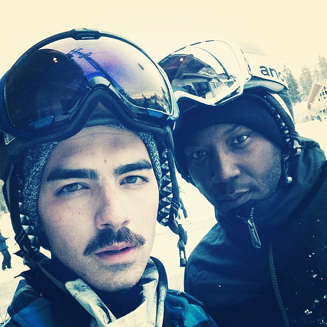 Joe Jonas hit the ski slopes with a friend and his killer mustache. Source: Instagram user joejonas