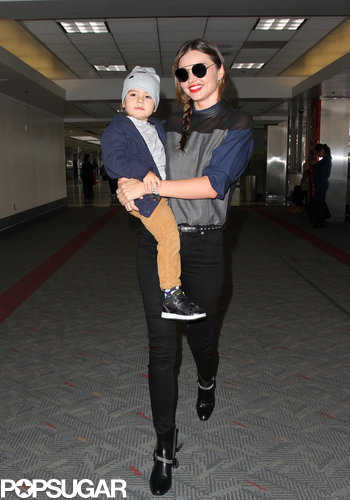 The best accessory spotted on Miranda Kerr's walk through LAX? Her adorable son.
