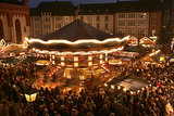 Visitors walked through the Christmas market at Roemerberg square in Frankfurt, Germany, on the opening day of the market.