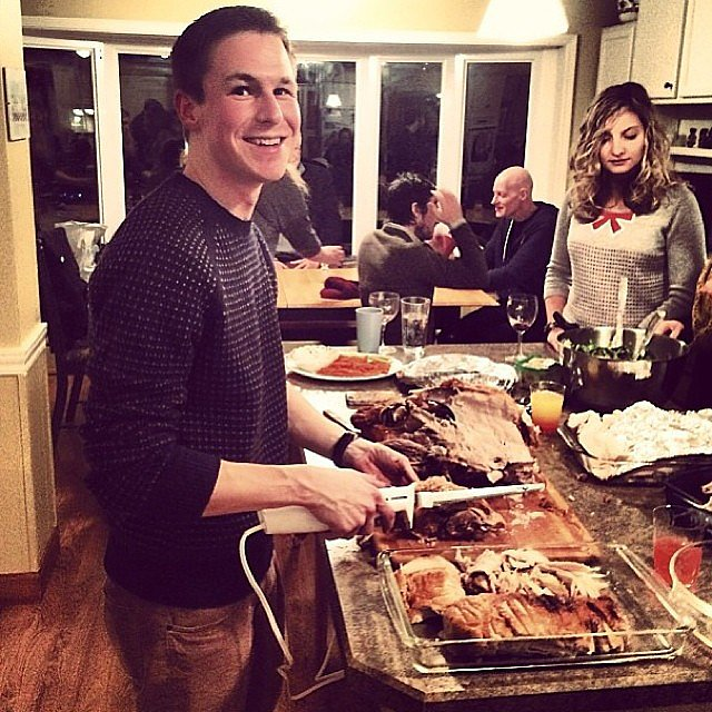 Model Erin Heatherton captured her cousin carving the turkey.  Source: Instagram user erinheathertonlegit