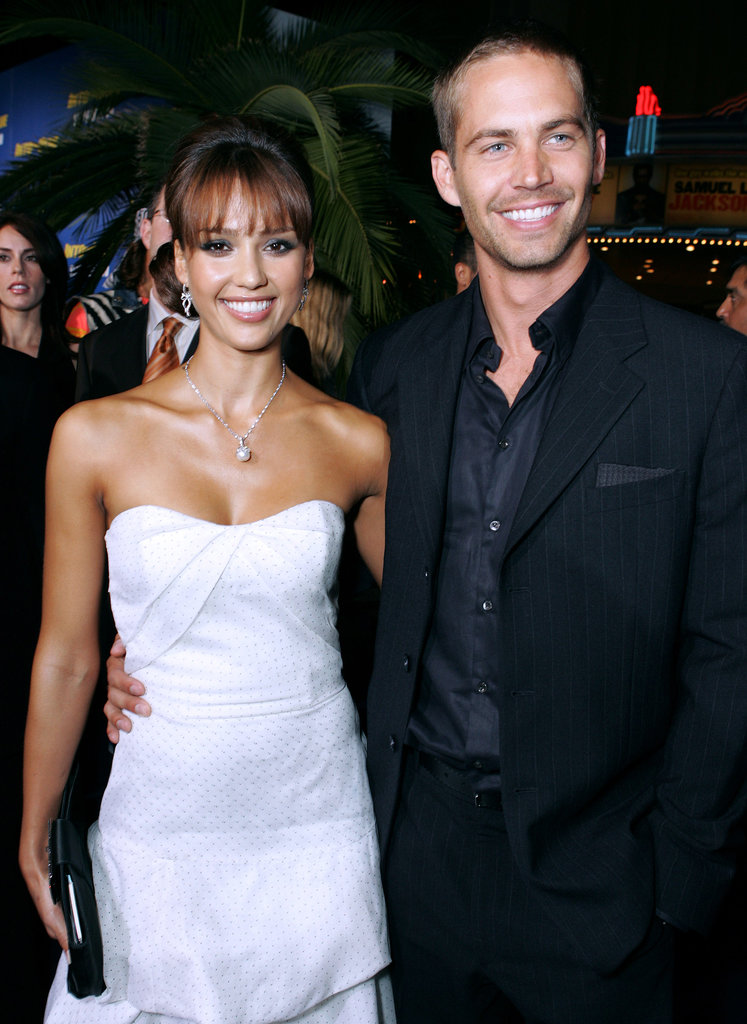 Paul Walker and Jessica Alba smiled for photos together at the LA premiere of their film Into the Blue in September 2005.