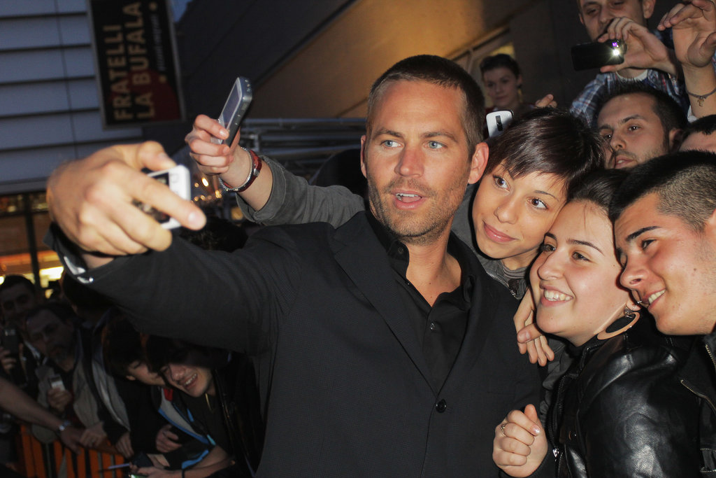 Paul Walker snapped photos with a group of fans during the Fast Five premiere in Rome, Italy, in April 2011.