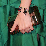To complement her bronze clutch, Sienna went with a similar metallic polish on her nails.